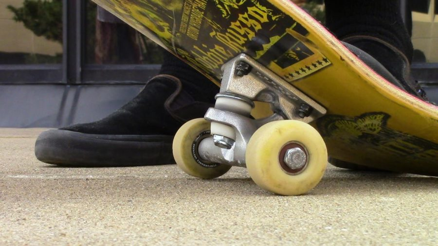 Chris Fenton-Wells sports the deck of his skateboard.