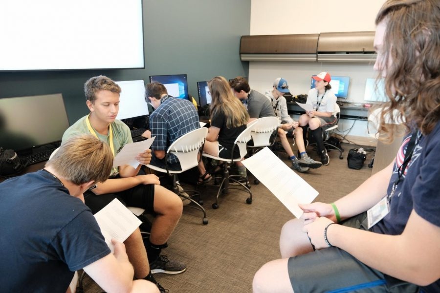 Students read over a handout after their lecture on media ethics.