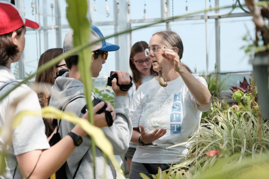 Dr. Maggie Whitson shows off the different types of plants.