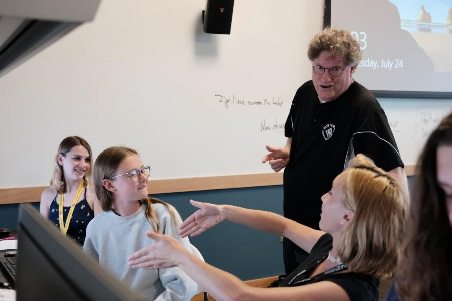Media professional Dean Hume helps students with their written projects.