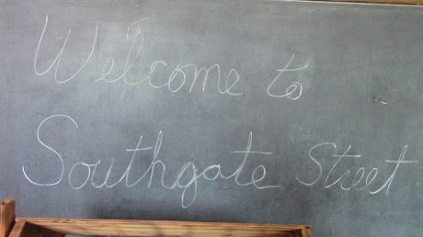 A chalkboard from the school greeting guests to the museum.